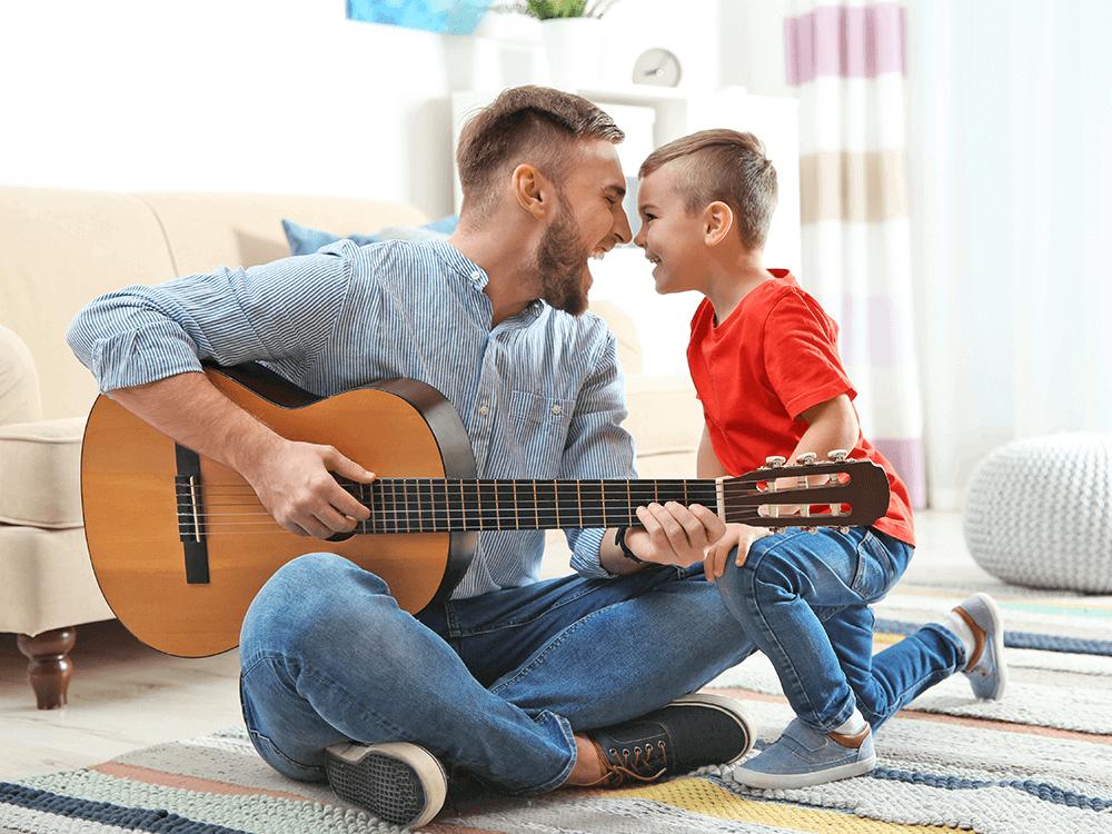 Imagen actividad 6: Papá y niño tocando guitarra y cantando juntos